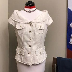 Cream White House Black Market cap sleeve blazer.
